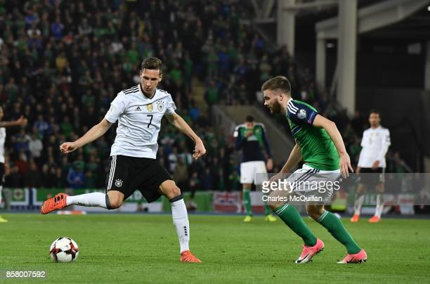 Stuart Dallas of Northern Ireland and Julian Draxler of Germany during the FIFA 2018 World Cup Qualifier between Northern Ireland and Germany at...