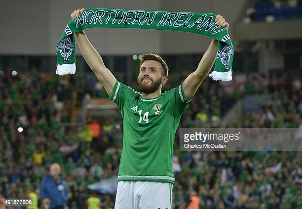 Stuart Dallas of Northern Ireland celebrates qualification after the UEFA EURO 2016 qualifier between Northern Ireland and Greece at Windsor Park on...