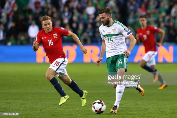 Stuart Dallas of Northern Ireland in action against Jonas Svensson of Norway during the FIFA 2018 World Cup Qualifier between Norway and Northern...