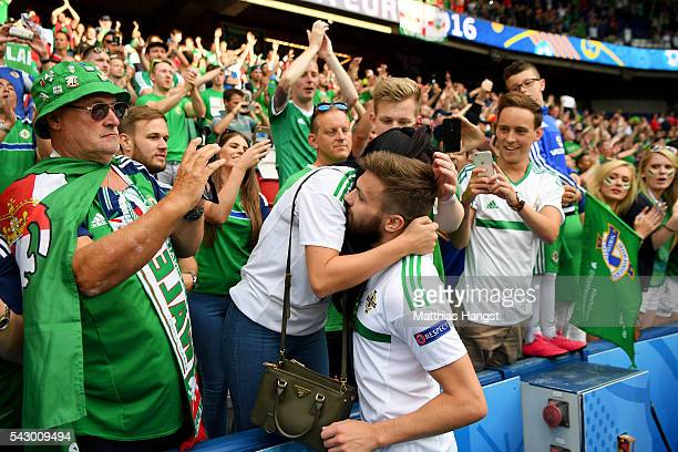 Stuart Dallas of Northern Ireland is consoled by supporters after the UEFA EURO 2016 round of 16 match between Wales and Northern Ireland at Parc des...