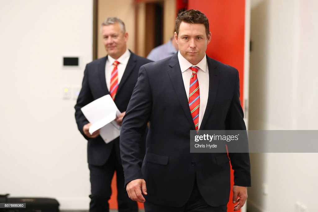 Stuart Dew arrives after being appointed Senior Coach during a Gold Coast Suns AFL press conference at their training facility on October 5, 2017 in Gold Coast, Australia.