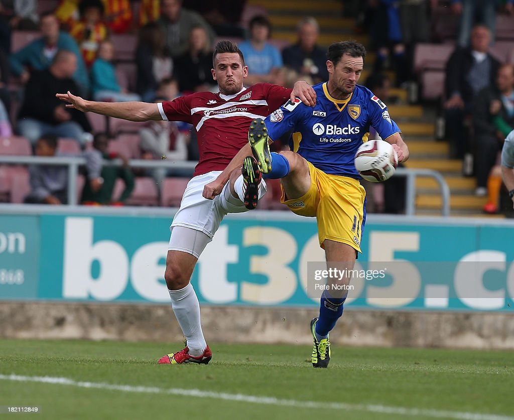 Stuart Drummond of Morecambe contests the ball with Darren Carter of Northampton Town during the Sky Bet League Two match between Northampton Town and Morecambe at Sixfields Stadium on September 28, 2013 in Northampton, England.
