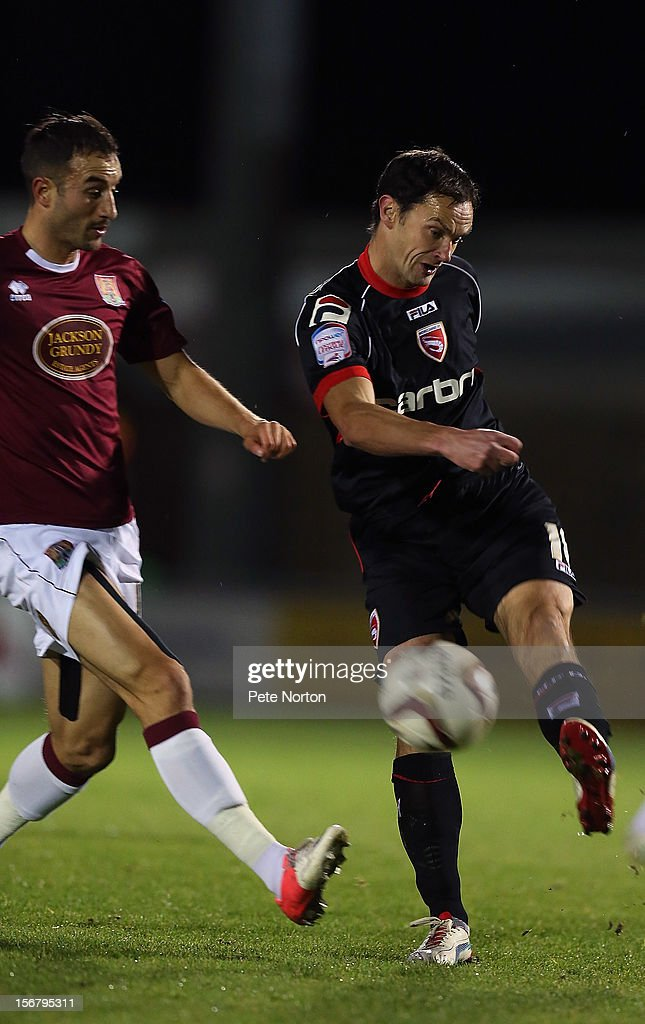 Stuart Drummond of Morecambe plays the ball past Chris Hackett of Northampton Town during the npower League Two match between Northampton Town and Morecambe at Sixfields Stadium on November 20, 2012 in Northampton, England.