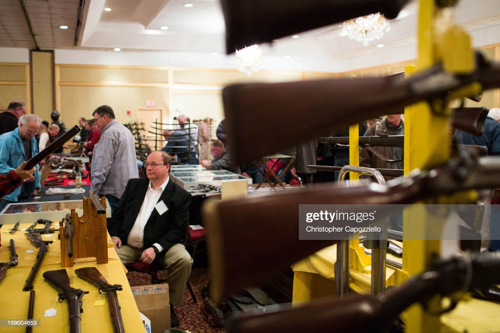 Stuart English of Milford, New Hampshire, sells antique guns at a gun show at the Crowne Plaza Hotel on January 5, 2013 in Stamford, Connecticut. While other area gun shows have been canceled following the shooting rampage that killed 20 first-graders and six teachers and administrators in Newtown, Connecticut last month, a gun show held by Westchester Collectors Inc. in Stamford, 30 miles from Newtown, is going on as planned.