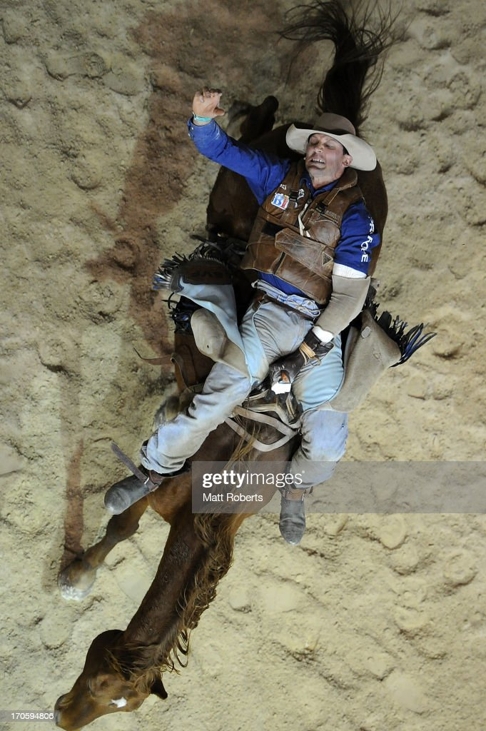 Stuart Frame of Monto competes Bareback Bronc Riding during the National Rodeo Finals on June 15, 2013 on the Gold Coast, Australia.