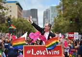 Stuart Gaffney and John Lewis plaintiffs in the 2008 Defense of Marriage Act case celebrate while traveling along Market Street during the annual Gay...