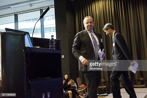 Stuart Gulliver chief executive officer of HSBC Holdings Plc center arrives on stage during a forum in Hong Kong China on Friday April 15 2016 Hong...
