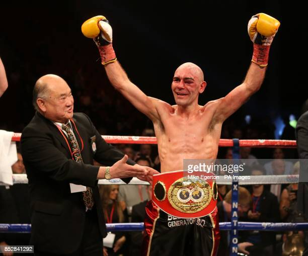 Stuart Hall is presented with his belt after victory over South African Vusi Malinga during their IBF Bantamweight title fight at the First Direct...