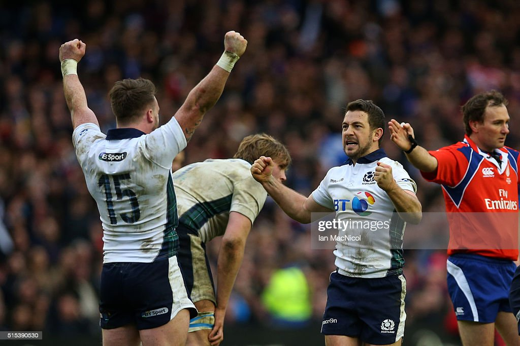 Stuart Hogg and Greig Laidlaw of Scotland celebrate victory as the final whistle blows during the RBS Six Nations match between Scotland and France at Murrayfield Stadium on March 13, 2016 in Edinburgh, Scotland.