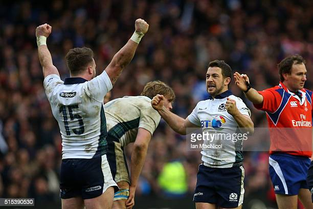 Stuart Hogg and Greig Laidlaw of Scotland celebrate victory as the final whistle blows during the RBS Six Nations match between Scotland and France...