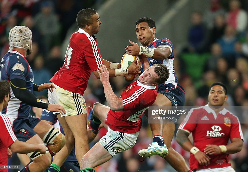 Stuart Hogg and <a gi-track='captionPersonalityLinkClicked' href=/galleries/search?phrase=Simon+Zebo&family=editorial&specificpeople=7036694 ng-click='$event.stopPropagation()'>Simon Zebo</a> of the Lions contest a high ball with Cooper Vuna of the Rebels during the International Tour Match between the Melbourne Rebels and the British & Irish Lions at AAMI Park on June 25, 2013 in Melbourne, Australia.