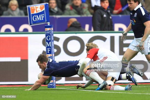 Stuart Hogg of Scotland dives over to score the opening try during the RBS Six Nations match between France and Scotland at Stade de France on...