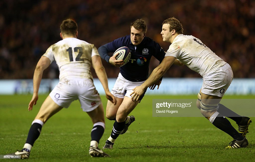 <a gi-track='captionPersonalityLinkClicked' href=/galleries/search?phrase=Stuart+Hogg+-+Rugbyer&family=editorial&specificpeople=8947952 ng-click='$event.stopPropagation()'>Stuart Hogg</a> of Scotland is tackled by <a gi-track='captionPersonalityLinkClicked' href=/galleries/search?phrase=Owen+Farrell&family=editorial&specificpeople=4809668 ng-click='$event.stopPropagation()'>Owen Farrell</a> of England and <a gi-track='captionPersonalityLinkClicked' href=/galleries/search?phrase=Joe+Launchbury&family=editorial&specificpeople=7440712 ng-click='$event.stopPropagation()'>Joe Launchbury</a> of England during the RBS Six Nations match between Scotland and England at Murrayfield Stadium on February 6, 2016 in Edinburgh, Scotland.