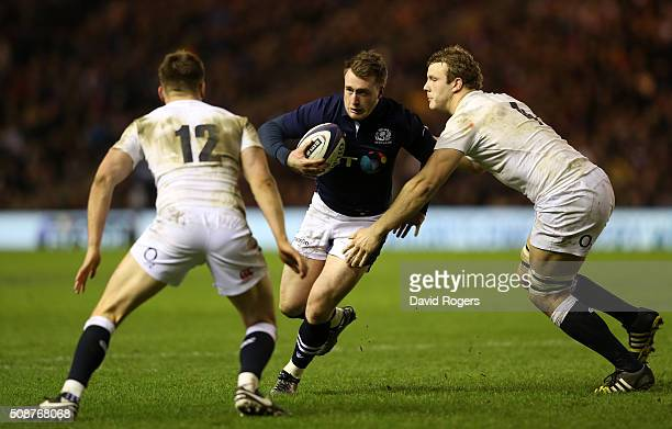 Stuart Hogg of Scotland is tackled by Owen Farrell of England and Joe Launchbury of England during the RBS Six Nations match between Scotland and...