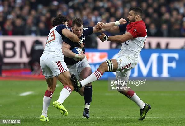 Stuart Hogg of Scotland is tackled by Yoann Huget and Damien Chouly of France during the RBS Six Nations match between France and Scotland at Stade...