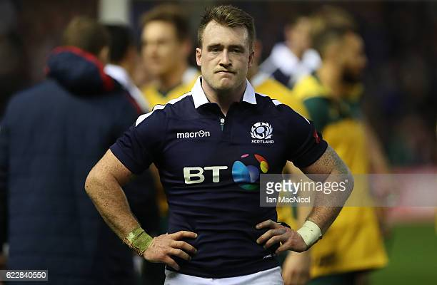 Stuart Hogg of Scotland looks on as Australian players celebrate at full time during the Scotland v Australia Autumn Test Match at Murrayfield...
