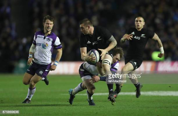 Stuart Hogg of Scotland tackles Liam Squire of New Zealand during the International test match between Scotland and New Zealand at Murrayfield...