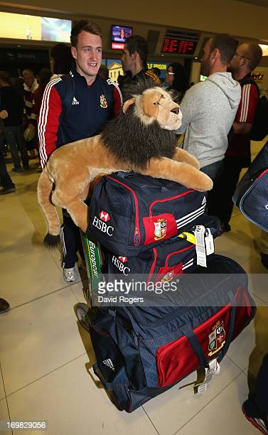 Stuart Hogg of the British and Irish Lions pushes a trolly loaded with his kit and tour mascot Bil as he arrives at Perth Airport on June 3 2013 in...