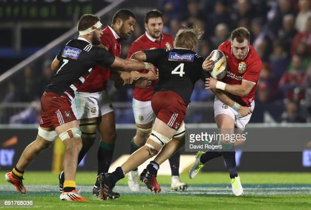 Stuart Hogg of the British Irish Lions is tackled by Joshua Goodhue of NZ Provincial Barbarians during the 2017 British Irish Lions tour match...