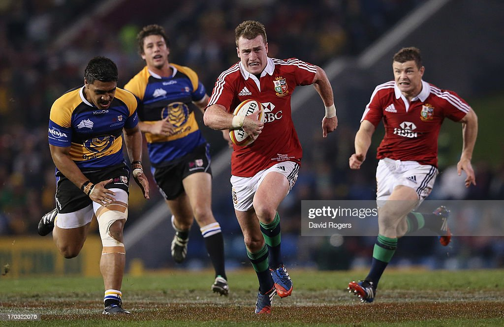 Stuart Hogg of the Lions breaks clear to score a try during the match between Combined Country and the British Irish Lions at Hunter Stadium on June...