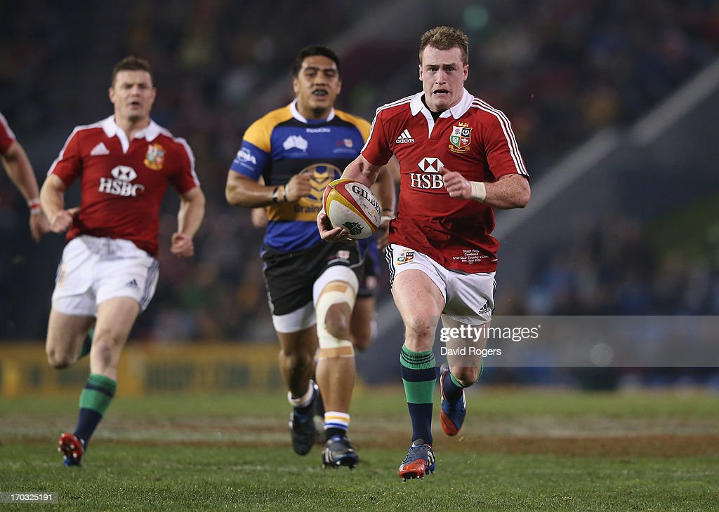 Stuart Hogg of the Lions breaks clear to score a try during the match between Combined Country and the British & Irish Lions at Hunter Stadium on June 11, 2013 in Newcastle, Australia.