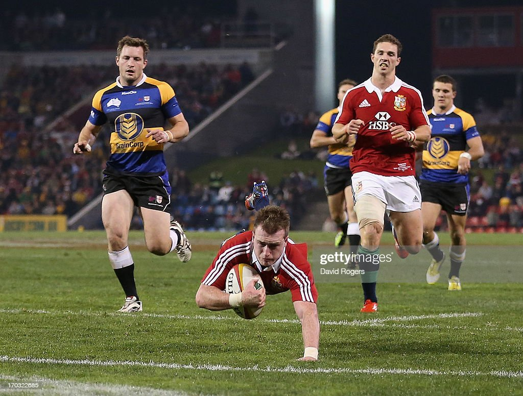 Stuart Hogg of the Lions dives over for a try during the match between Combined Country and the British & Irish Lions at Hunter Stadium on June 11, 2013 in Newcastle, Australia.
