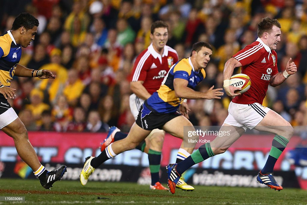 Stuart Hogg of the Lions makes a break on his way to score a try during the match between Combined Country and the British & Irish Lions at Hunter Stadium on June 11, 2013 in Newcastle, Australia.