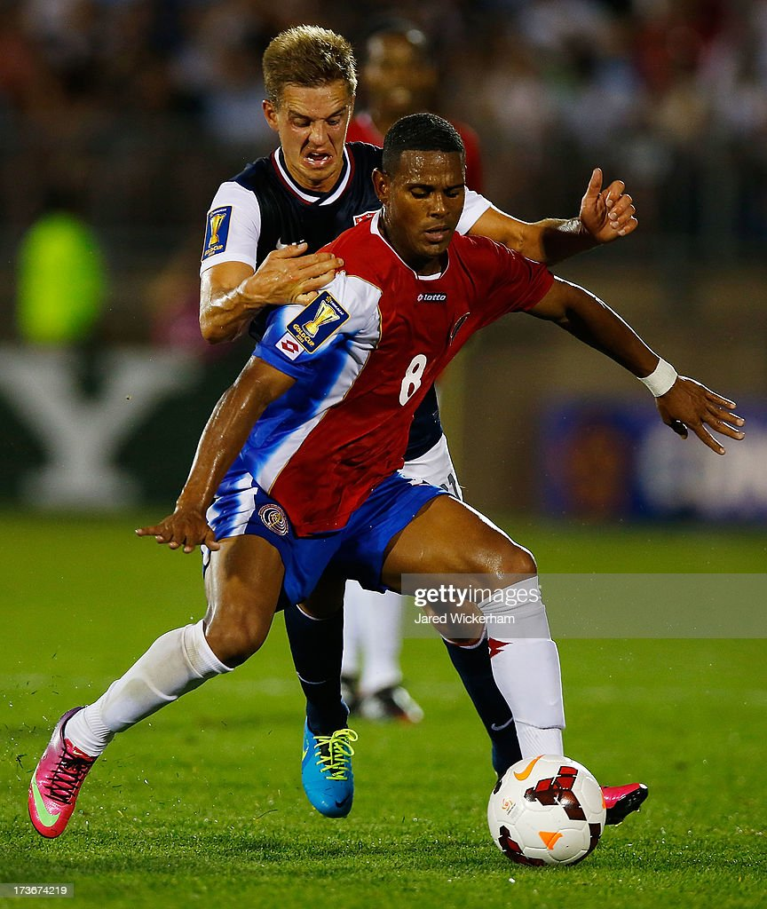 Stuart Holden #11 of the United States fights for the ball against Kenny Cunningham #8 of Costa Rica during the CONCACAF Gold Cup match at Rentschler Field on July 16, 2013 in East Hartford, Connecticut.