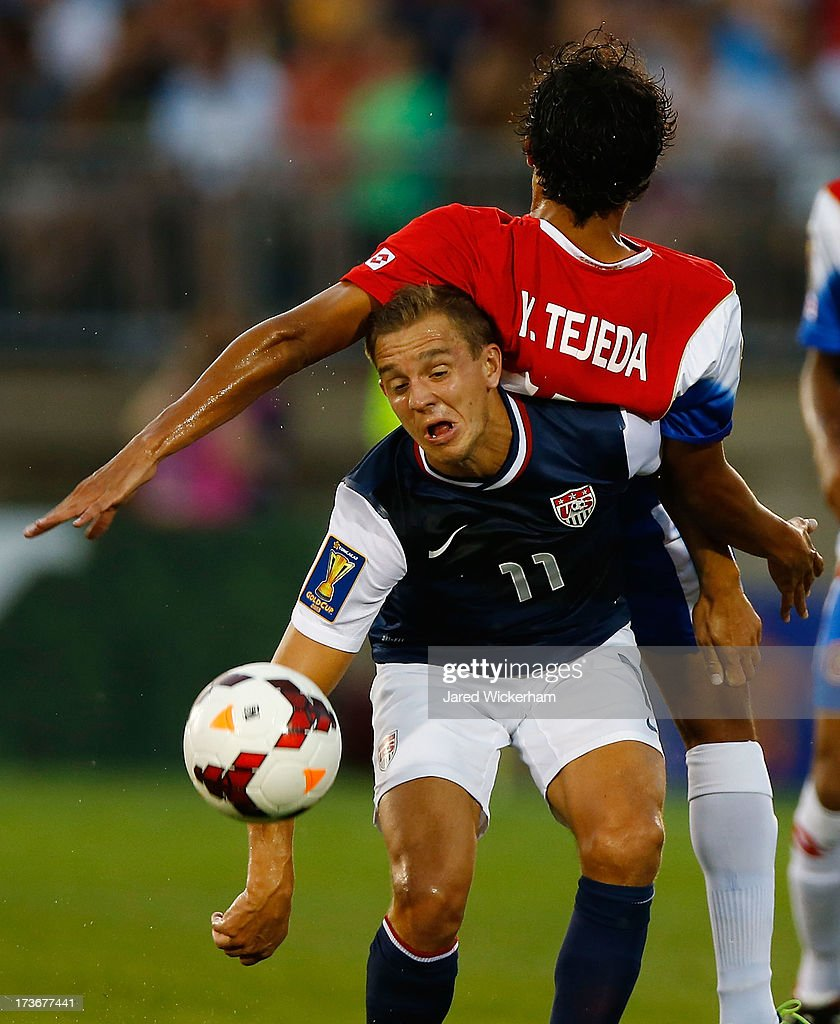<a gi-track='captionPersonalityLinkClicked' href=/galleries/search?phrase=Stuart+Holden&family=editorial&specificpeople=2581133 ng-click='$event.stopPropagation()'>Stuart Holden</a> #11 of the United States goes up for a header underneath Yeltsin Tejeda #17 of Costa Rica in the first half during the CONCACAF Gold Cup match at Rentschler Field on July 16, 2013 in East Hartford, Connecticut.