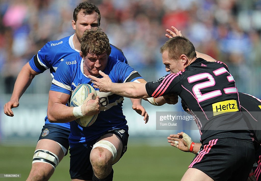 <a gi-track='captionPersonalityLinkClicked' href=/galleries/search?phrase=Stuart+Hooper&family=editorial&specificpeople=211089 ng-click='$event.stopPropagation()'>Stuart Hooper</a> of Bath is tackled by Paul Warwick of Stade Francais during the Amlin Challenge Cup Quarter Final match between Bath and Stade Francais at the Recreation Ground on April 06, 2013 in Bath, England.