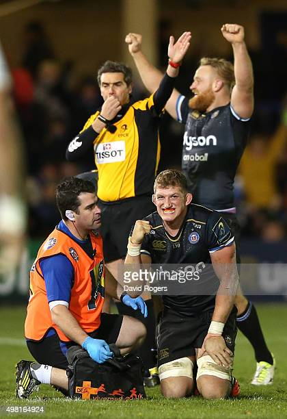 Stuart Hooper the Bath captain celebrates his teams narrow victory during the European Rugby Champions Cup match between Bath and Leinster at the...