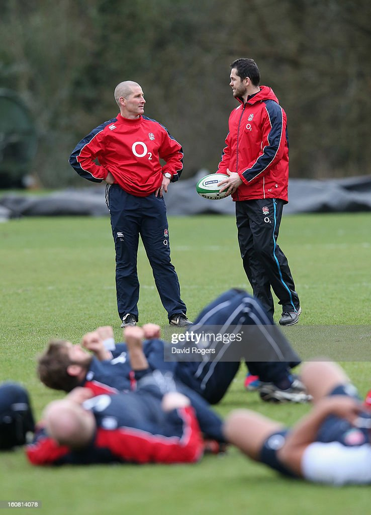 Stuart Lancaster (L) England head coach talks to Andy Farrell, the England backs coach during the England training session held at Pennyhill Park on February 6, 2013 in Bagshot, England.