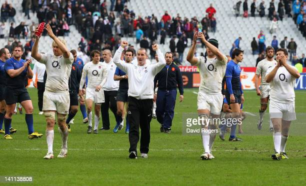 Stuart Lancaster head coach of England celebrates victory with his players after the RBS 6 Nations match between France and England at Stade de...