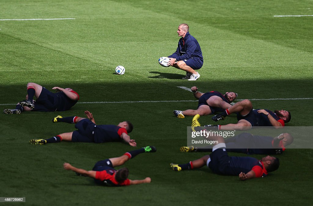 Stuart Lancaster Head Coach of England looks on as players stretch during the England Captain's Run on the eve of the opening Rugby World Cup 2015...