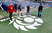 Stuart Lancaster the England coach and team captain Chris Robshaw walk onto the pitch as groundsman sweep the Scottish emblem during the England...
