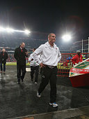 Stuart Lancaster the England head coach leaves the walks down the tunnel after his team are defeated during the second test match between South...