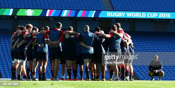 Stuart Lancaster the England head coach looks on as his team gather during the England captain's run at the City of Manchester Stadium on October 9...