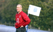 Stuart Lancaster the England head coach looks on during the England training session held at Pennyhill Park on January 31 2012 in Bagshot England