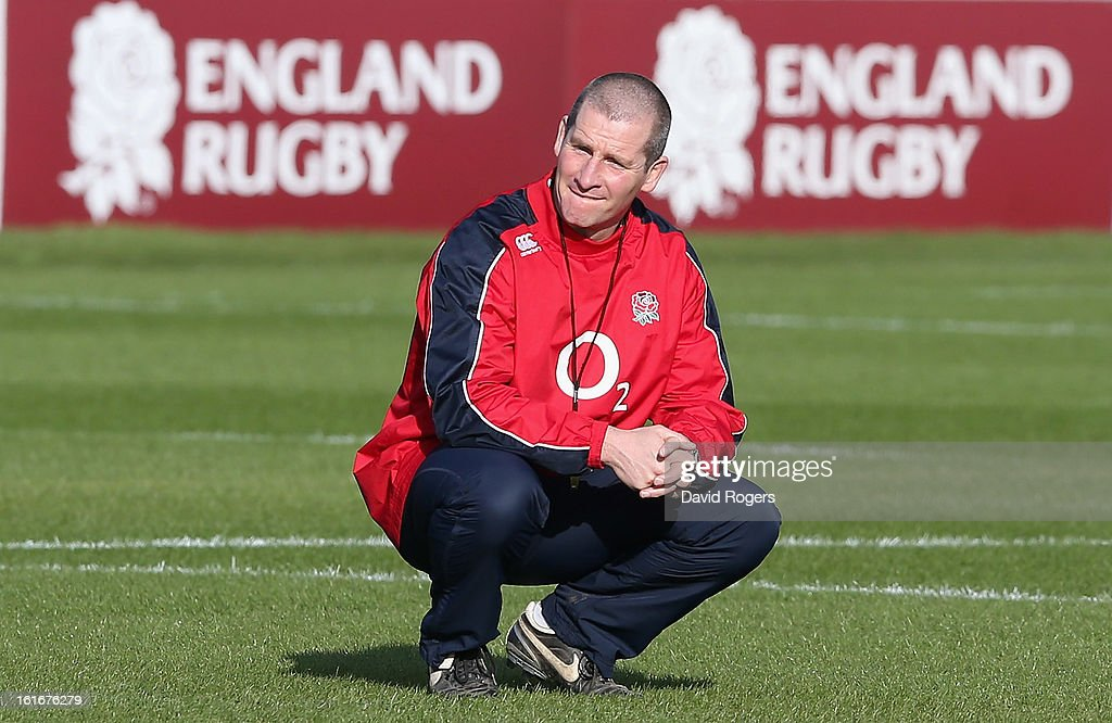 Stuart Lancaster, the England head coach looks on during the England training session held at St Georges Park on February 14, 2013 in Burton-upon-Trent, England.
