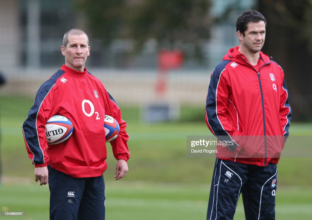 Stuart Lancaster, (L) the England head coach looks on with backs coach Andy Farrell during the England training session held at St Georges Park on October 29, 2012 in Burton-upon-Trent, England.