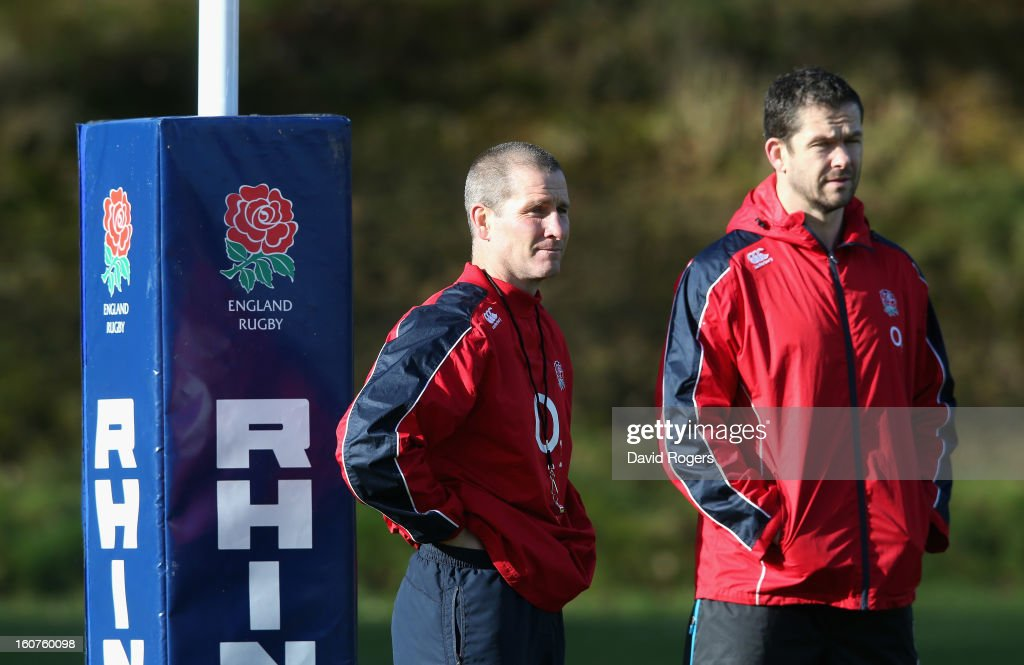 Stuart Lancaster,(L) the England head coach, looks on with backs coach Andy Farrell during the England training session at Pennyhill Park on February 5, 2013 in Bagshot, England.
