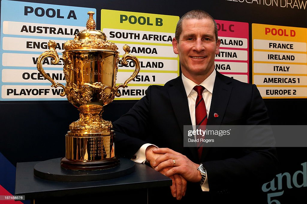<a gi-track='captionPersonalityLinkClicked' href=/galleries/search?phrase=Stuart+Lancaster&family=editorial&specificpeople=2263180 ng-click='$event.stopPropagation()'>Stuart Lancaster</a> the England head coach poses with the Webb Ellis trophy during the media session following IRB Rugby World Cup 2015 pool allocation draw at the Blue Fin Building on December 3, 2012 in London, England.