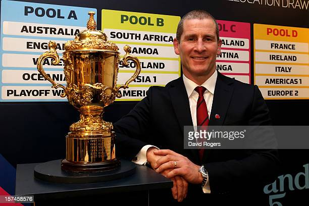 Stuart Lancaster the England head coach poses with the Webb Ellis trophy during the media session following IRB Rugby World Cup 2015 pool allocation...