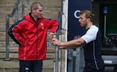 Stuart Lancaster the England head coach talks to team captain Chris Robshaw during the England captain's run at Twickenham Stadium on November 16...