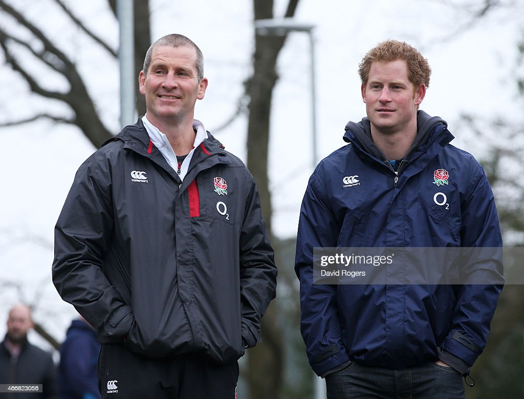 Stuart Lancaster the head coach of England and Prince Harry chat during the England Training Session at Pennyhill Park on March 19 2015 in Bagshot...