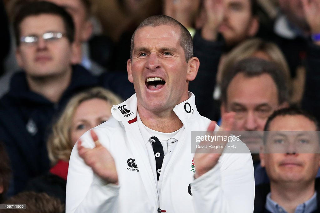 Stuart Lancaster the head coach of England celebrates after winning the QBE international match between England and Australia at Twickenham Stadium...