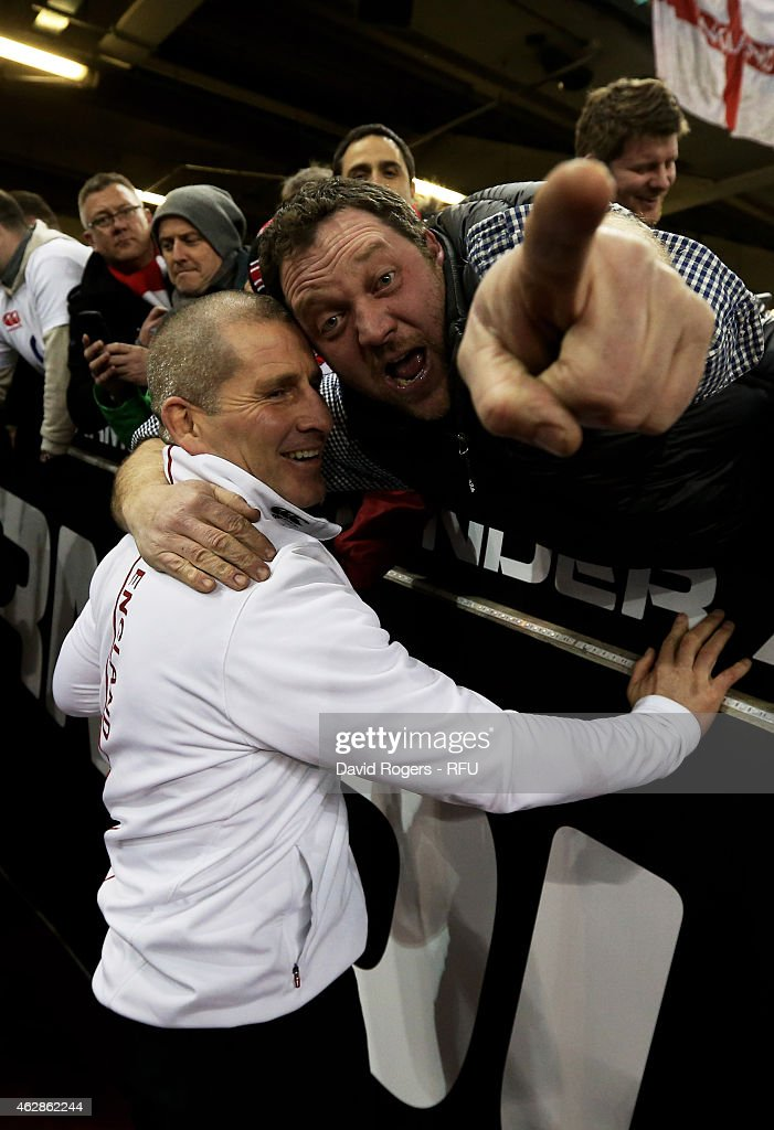 Stuart Lancaster the head coach of England celebrates with a fan following their team's 2116 victory during the RBS Six Nations match between Wales...