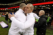 Stuart Lancaster the head coach of England celebrates with Mike Catt the England attacking skills coach following their team's 2116 victoryduring the...