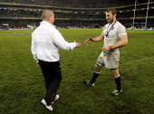 Stuart Lancaster the Head Coach of England shakes hands with England captain Chris Robshaw following their team's victory during the RBS Six Nations...