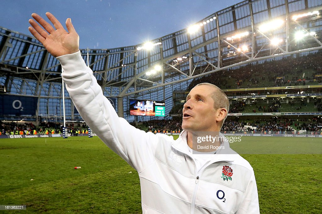 Stuart Lancaster the Head Coach of England waves to the fans following his team's victory during the RBS Six Nations match between Ireland and England at Aviva Stadium on February 10, 2013 in Dublin, Ireland.